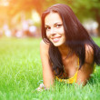Sexy brunette on grass — Stock Photo