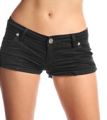 Front side of young sexy woman wearing jean shorts — Stock Photo