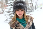 A winter portrait of a blonde with a fur hat — Stock Photo