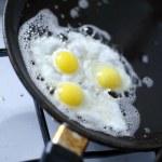 Broken egg frying in a pan — Stock Photo