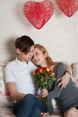 Roses and young couple — Stock Photo
