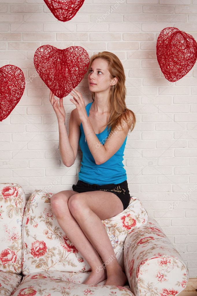 Young woman with red heart in hands, in day Valentine — Stock Photo #8762023