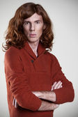 Young man with the long, auburn hair — Stock Photo