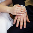Newlyweds holding hands — Stock Photo