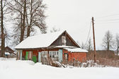 Haus im Schnee — Stockfoto
