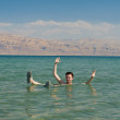 Man floating in the waters of the Dead Sea — Stock Photo #8567285