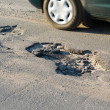 Royalty-Free Stock Photo: Asphalt`s holes on roadbed.