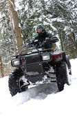 Special force man on quadbike. — Stock Photo