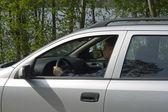Man driving a silver car. — Stock Photo