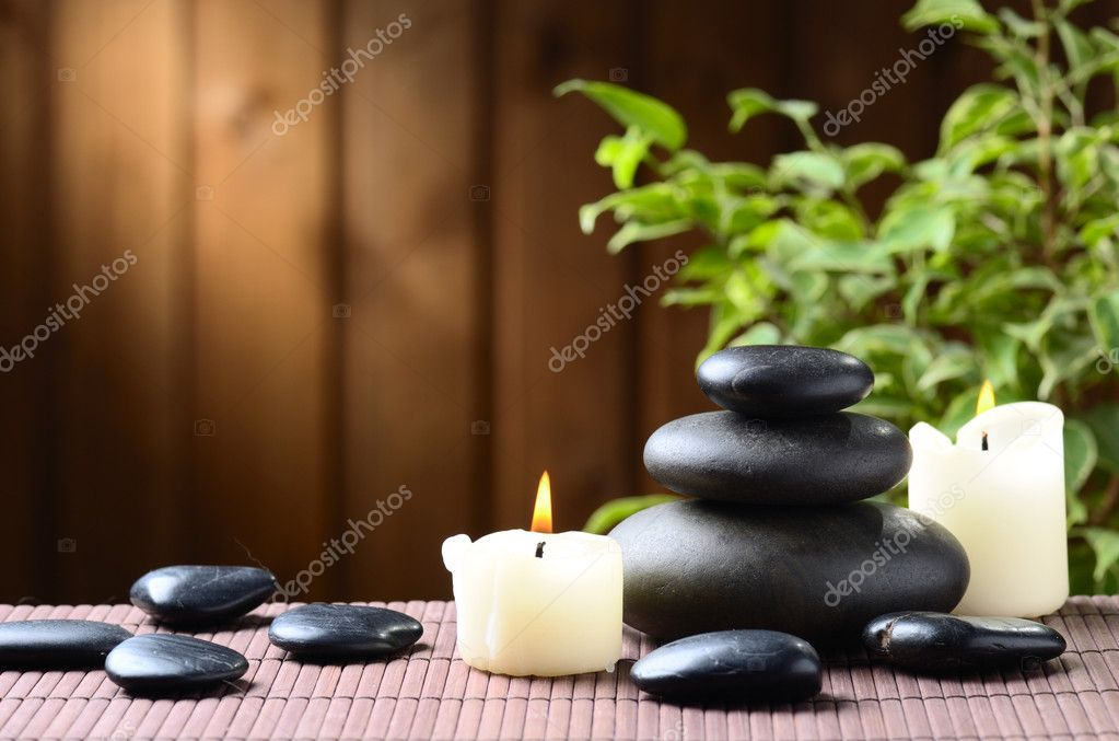 Zen basalt stones and bamboo on the wood — Stock Photo #9689314