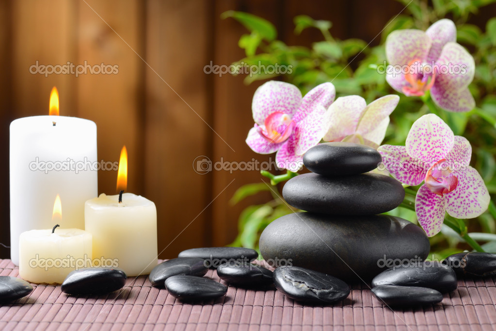 Zen basalt stones and bamboo on the wood — Stock Photo #9689323