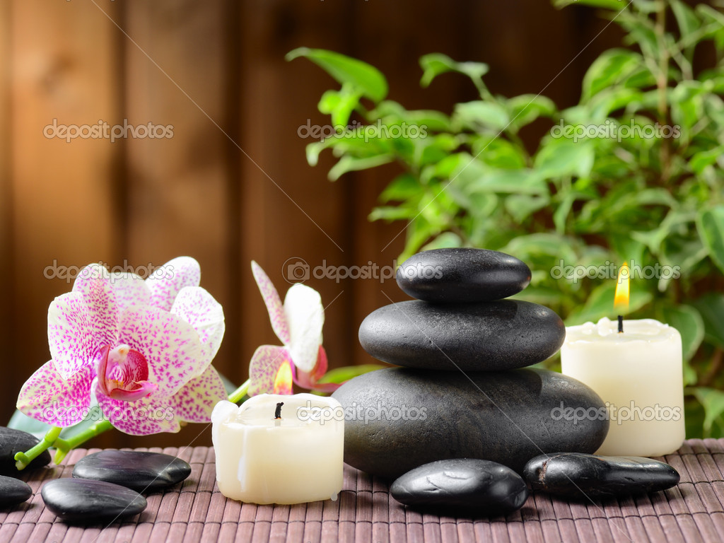 Zen basalt stones and bamboo on the wood — Stock Photo #9689355