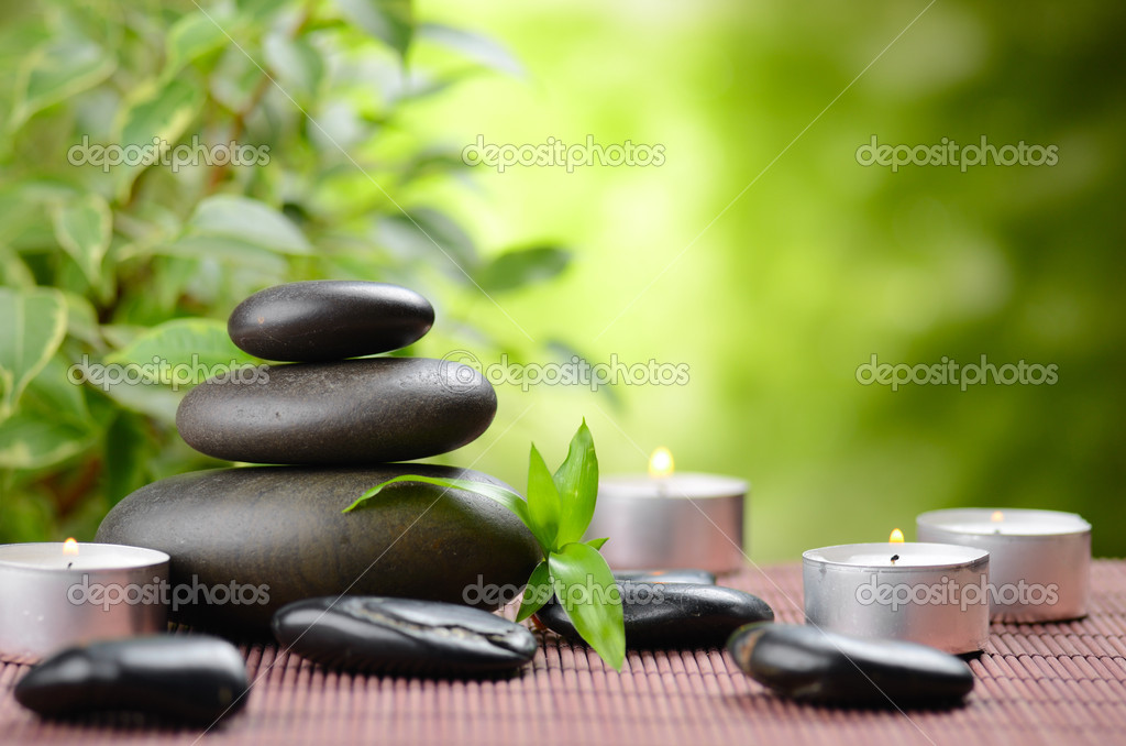 Zen basalt stones and bamboo on the wood — Stock Photo #9689363