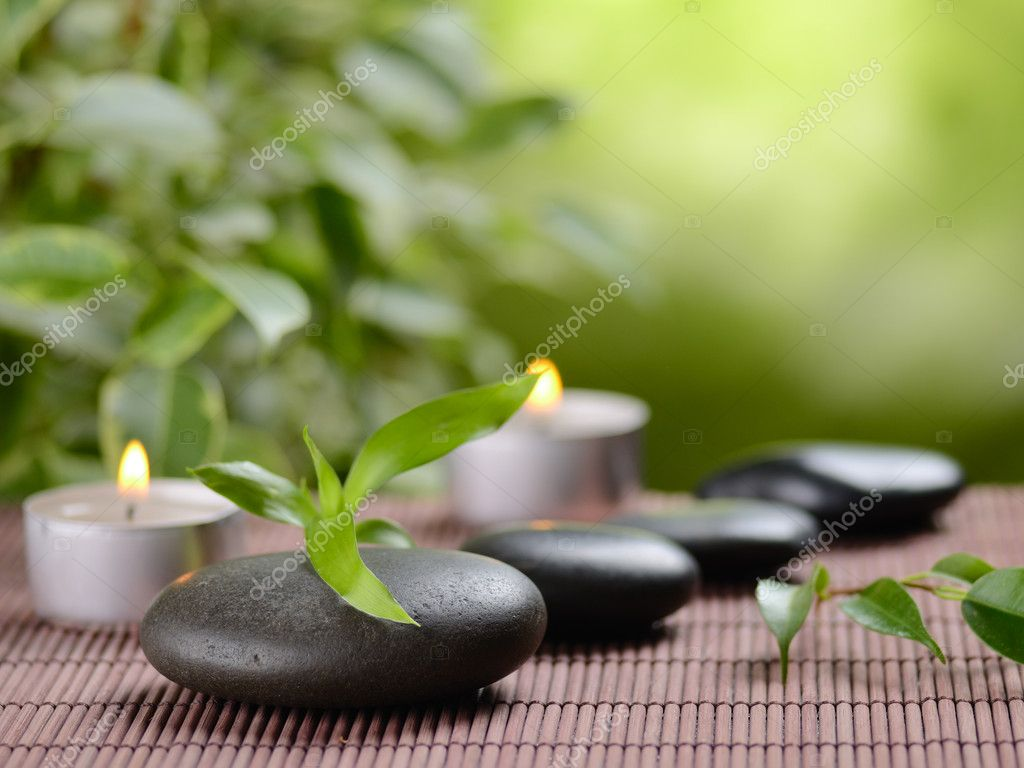 Zen basalt stones and bamboo on the wood — Stock Photo #9689367