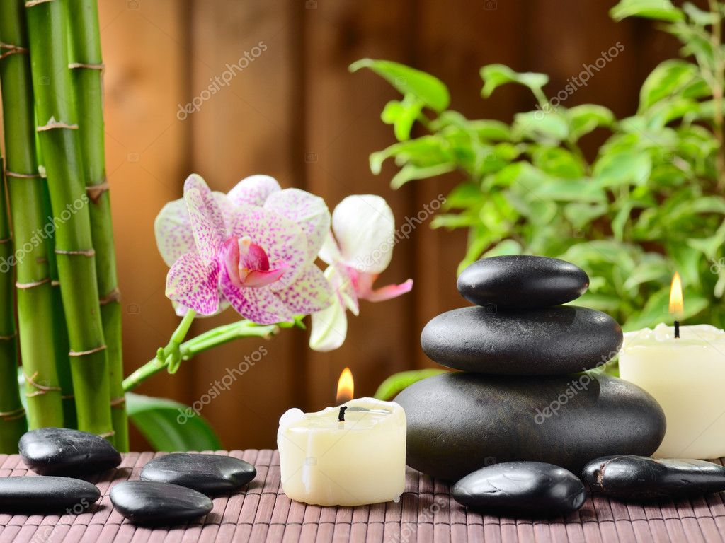 Zen basalt stones and bamboo on the wood — Stock Photo #9689383