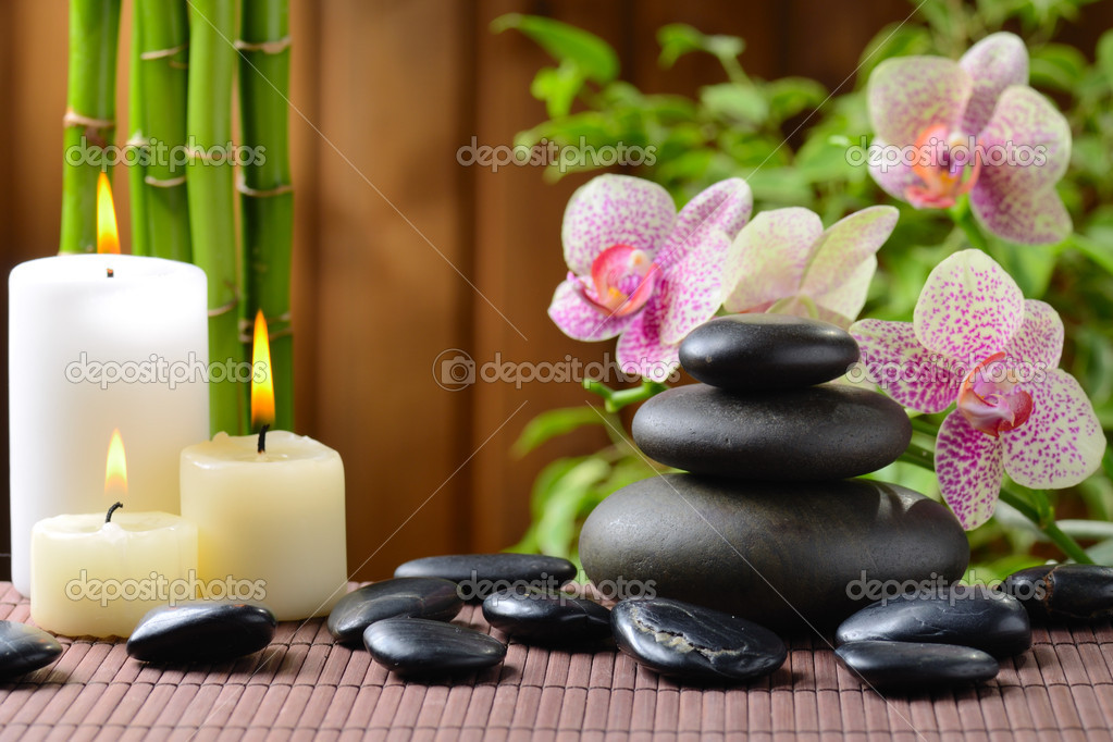 Zen basalt stones and bamboo on the wood — Stock Photo #9689394