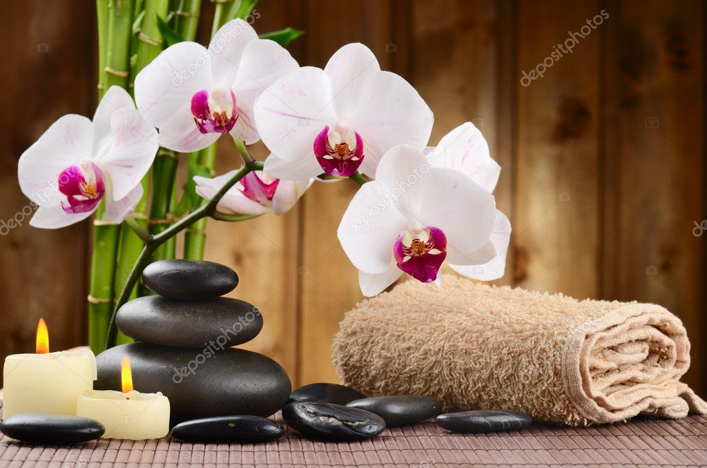Zen basalt stones and bamboo on the wood — Stock Photo #9689397
