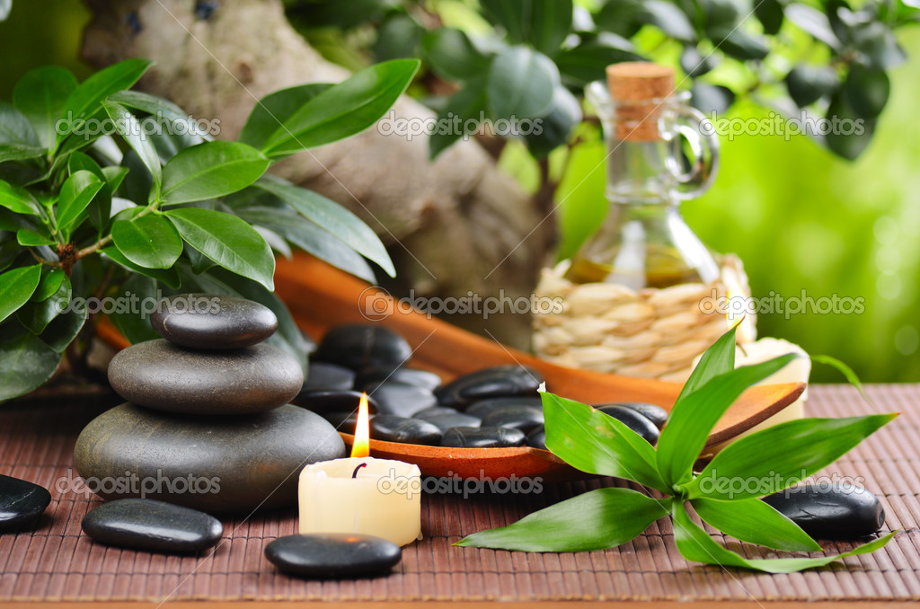 Zen basalt stones and bamboo on the wood — Stock Photo #9689490