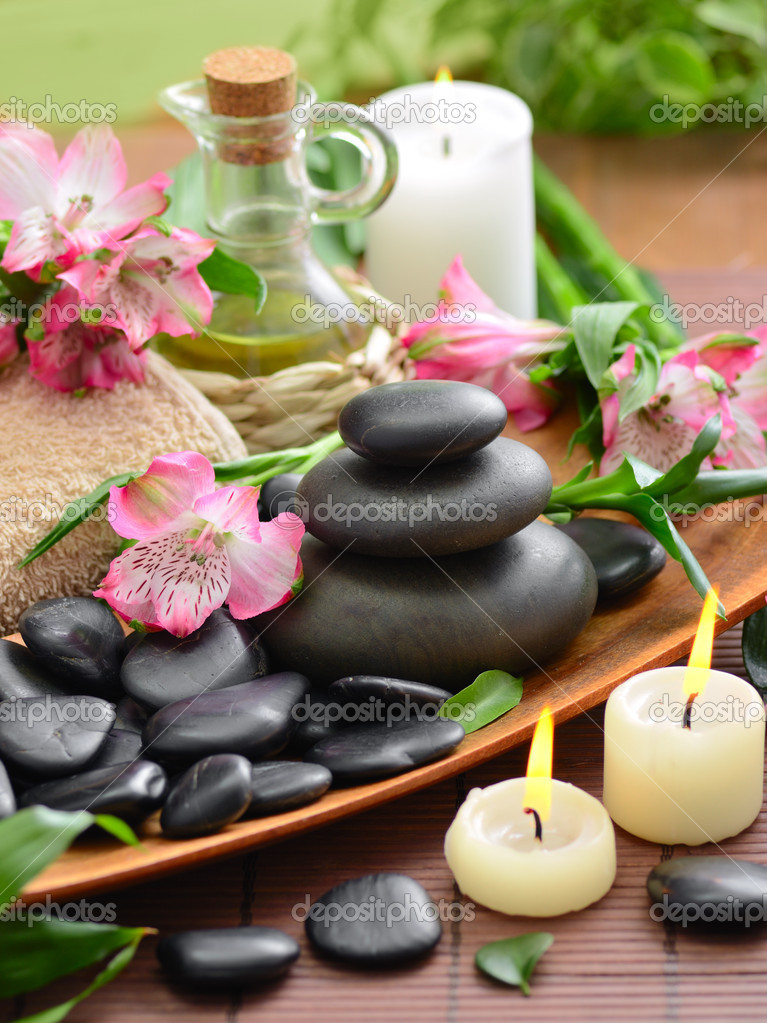 Zen basalt stones and bamboo on the wood — Stock Photo #9689518
