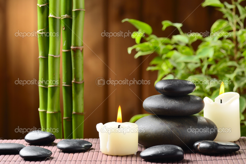 Zen basalt stones and bamboo on the wood — Stock Photo #9689521