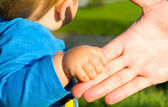 Hands of child son and father — Stock Photo