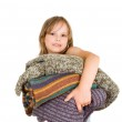 Little girl with stack of sweaters — Stock Photo #8979302