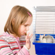 Child plays with a rat in a cage — Stock Photo