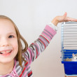 Child plays with a rat in a cage — Stock Photo #8979451