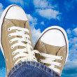 Sneakers and sky — Stock Photo