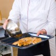 Chef frying chicken fillet - Stock Photo
