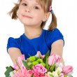 Stock Photo: Little girl with a bouquet of flowers. isolated on white