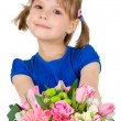 Little girl with a bouquet of flowers. isolated on white — Stock Photo