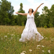Happy woman in field — Stock Photo #10598074