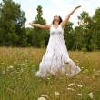 Stock Photo: Happy woman in field