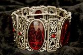Bracelet with red stones — Stock Photo