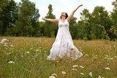 Happy woman in field — Stock Photo