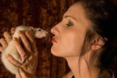 Woman kissed rat — Stock Photo