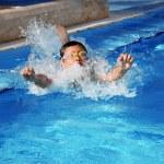 Boy in the pool — Stock Photo #10099237