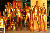 Gold mannequins — Stock Photo