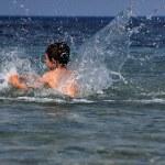 Boy in sea with splash — Stock Photo #10379155