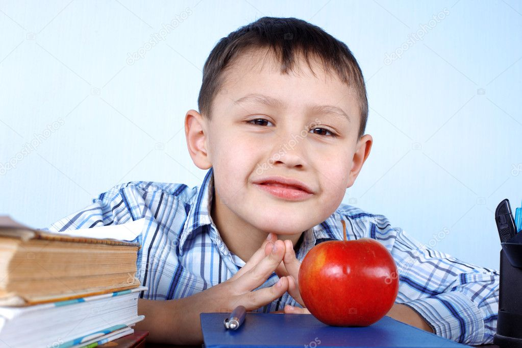 Schoolboy with red apple and books — Stock Photo #10379186