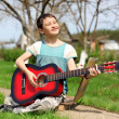 Music student playing the guitar outdoors — Stock Photo #10733506