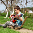 Music student playing the guitar outdoors — Stock Photo #10733514