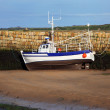 Stock Photo: Small boat at ebb tide waiting for rising water