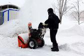Snowblower in city under snowfall — Stock Photo