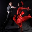 Dancers in action against black background — Stock Photo #9082368