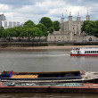 Tower of London on the Thames river with boat, UK — Stock Photo #9345846