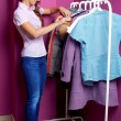 Women trying on clothes at shopping mall indoors — Foto Stock