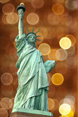 Statue of Liberty against light circle as fireworks or night cit — Stok fotoğraf