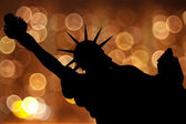 Silhouette NY Statue of Liberty against light circle as firework — Stok fotoğraf